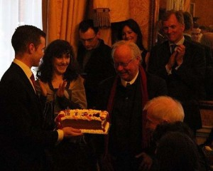 Arts Minister Jimmy Deenihan looks on as Brendan Kennelly blows out the candles.