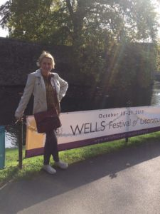 "Eve McDonnell, Winner of the Childrens' Book award at the Wells Festival of Literature for her book, ""Elsetime"", poses before a banner at the festival"